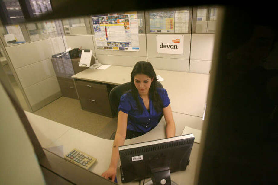 Rather than slash its internship program, Devon Energy is expanding it. One of those interns, Rebeca Gonzalez, is among those on staff now experiencing their first down cycle in the oil and natural gas business. Photo: Mayra Beltran :, Chronicle