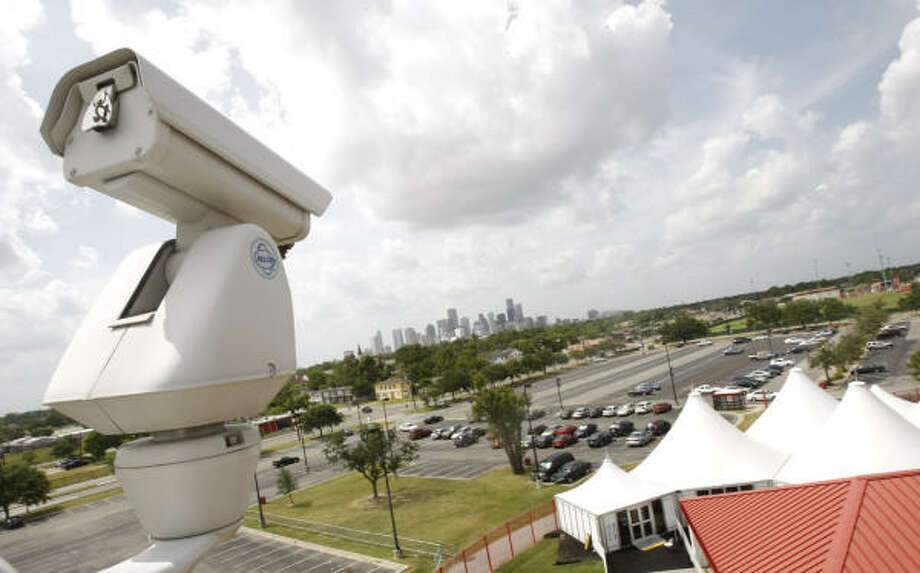 A security camera points toward a parking lot near Scott Street on the University of Houston's main campus. Photo: Julio Cortez, Houston Chronicle