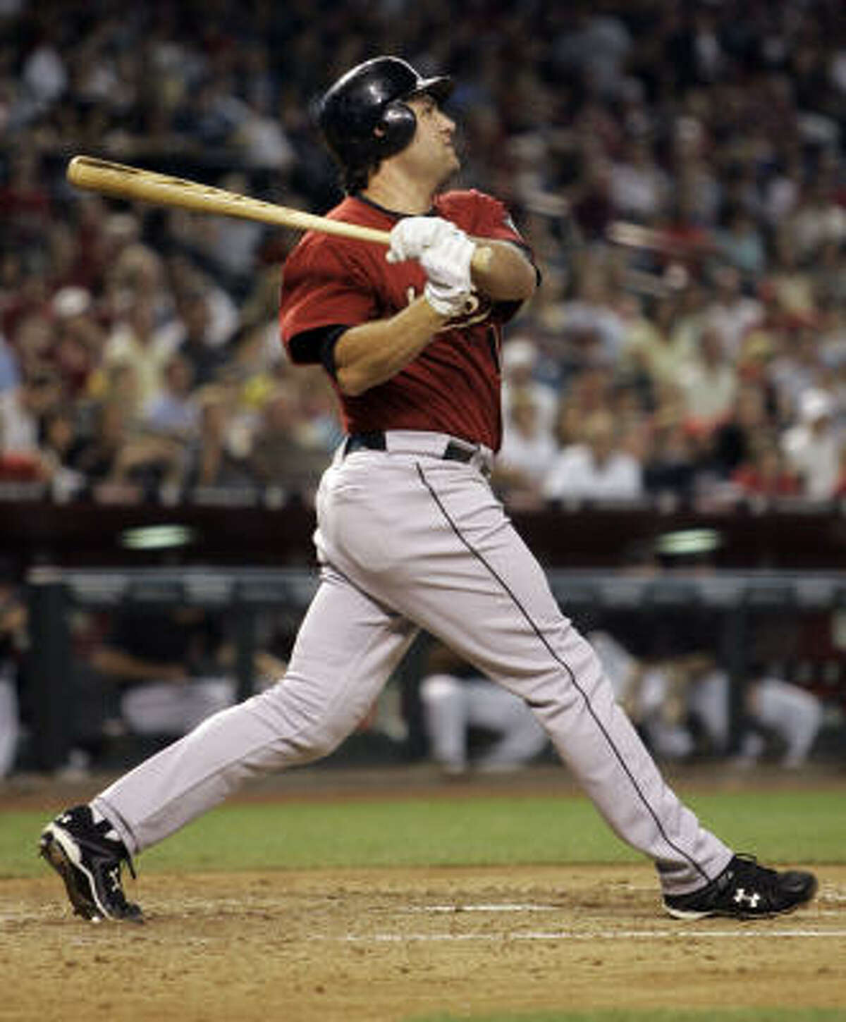 The Astros' Lance Berkman connects for his 300th career home run during the sixth inning against Arizona.