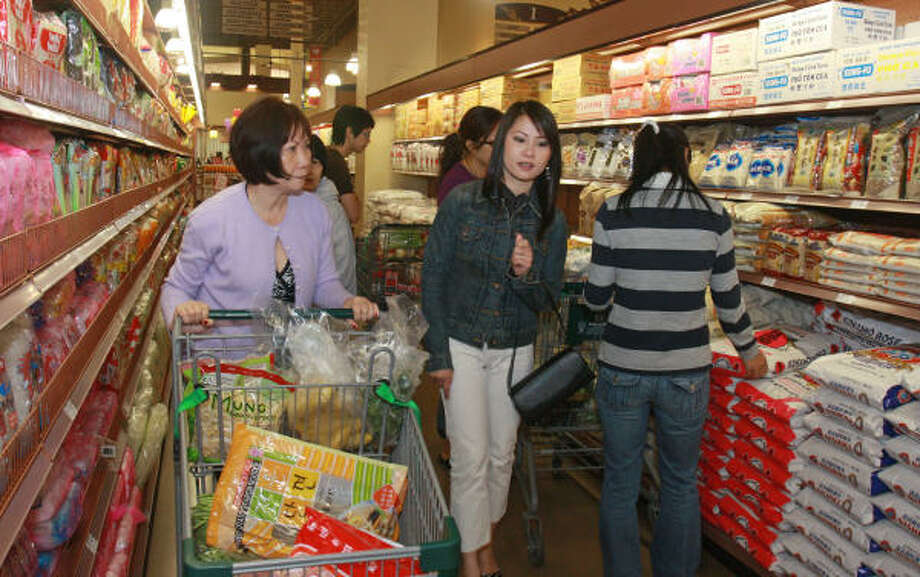 Chan Ngoc, left, and her niece Tracy Luu shop for dried noodles and rice at The 99 Ranch Market off Interstate 10 at Blalock. Luu lives in Houston, and her aunt is visiting from Great Britain. A grand opening is this Saturday. Photo: GARY FOUNTAIN:, FOR THE CHRONICLE