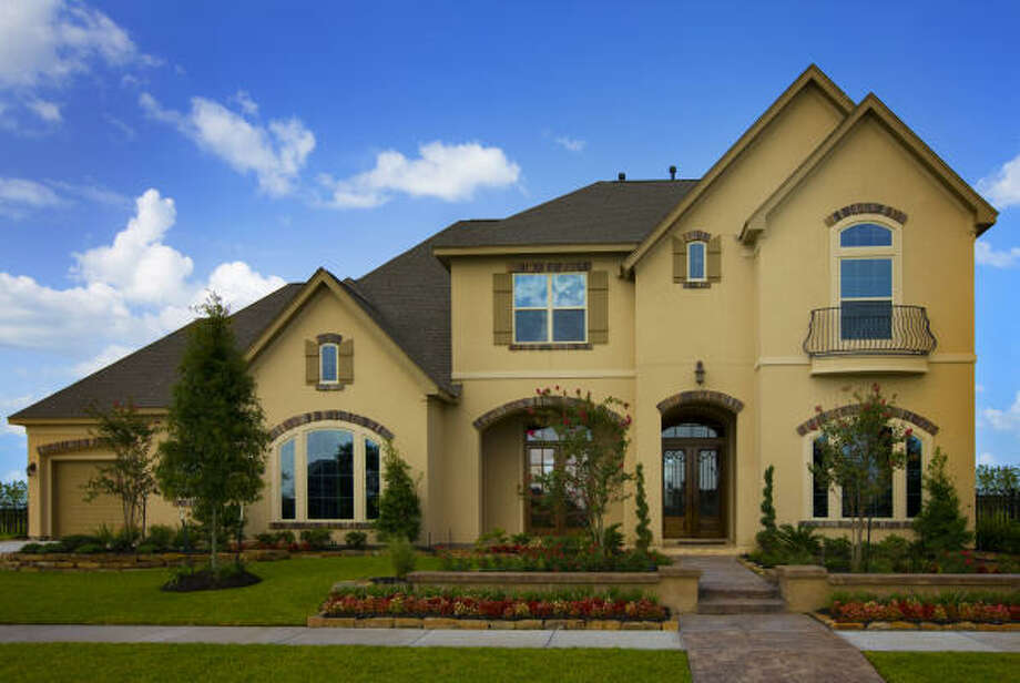 IN RESERVE: Tommy Bailey Homes has two completed homes in The Reserve, including a 5,010-square-foot design at 17522 West Bremonds Bend Court, priced at $800,000. The Reserve at First Bend is a gated enclave with 27 water-view homesites.