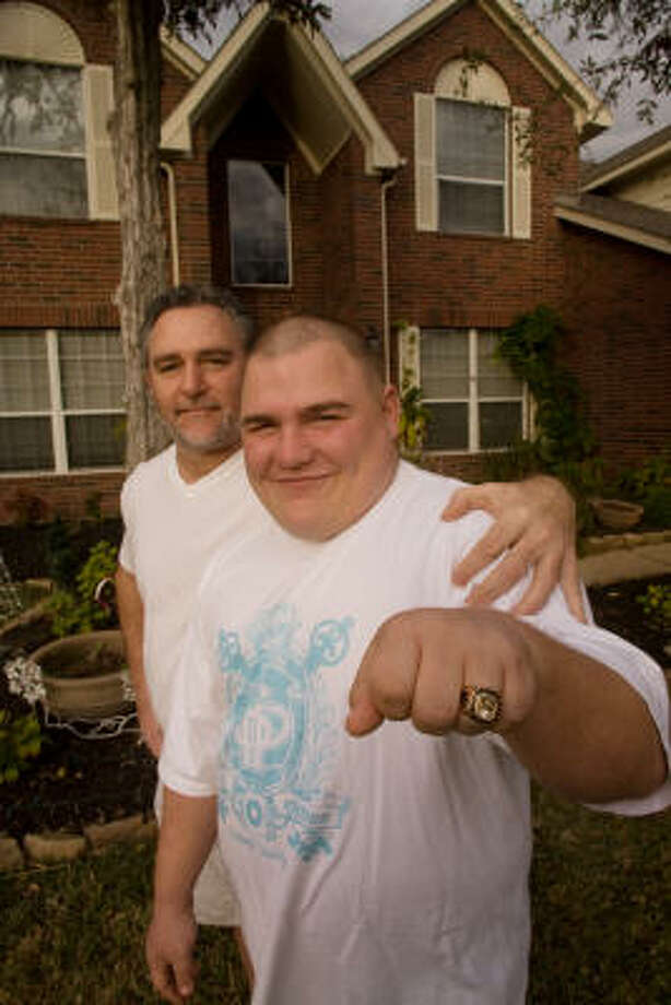 Derek Schottle, 19, pictured with his father, Gary, shows off his Big 12 Special Olympian of the Year ring. Photo: R. Clayton McKee, For The Chronicle
