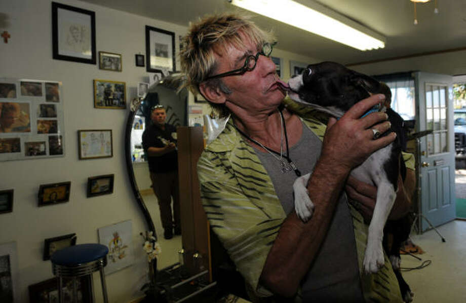 MAN?S BEST FRIEND: Kai Gertzen gets a lick from his dog, Ms. Sophie, at his hair salon. Photo: Kim Christensen, For The Chronicle