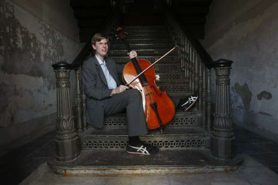 Evan Leslie, shown in the U.S. Custom House in Galveston, is one of the organizers of a series of chamber music concerts at historical buildings. Photo: Julio Cortez, Chronicle