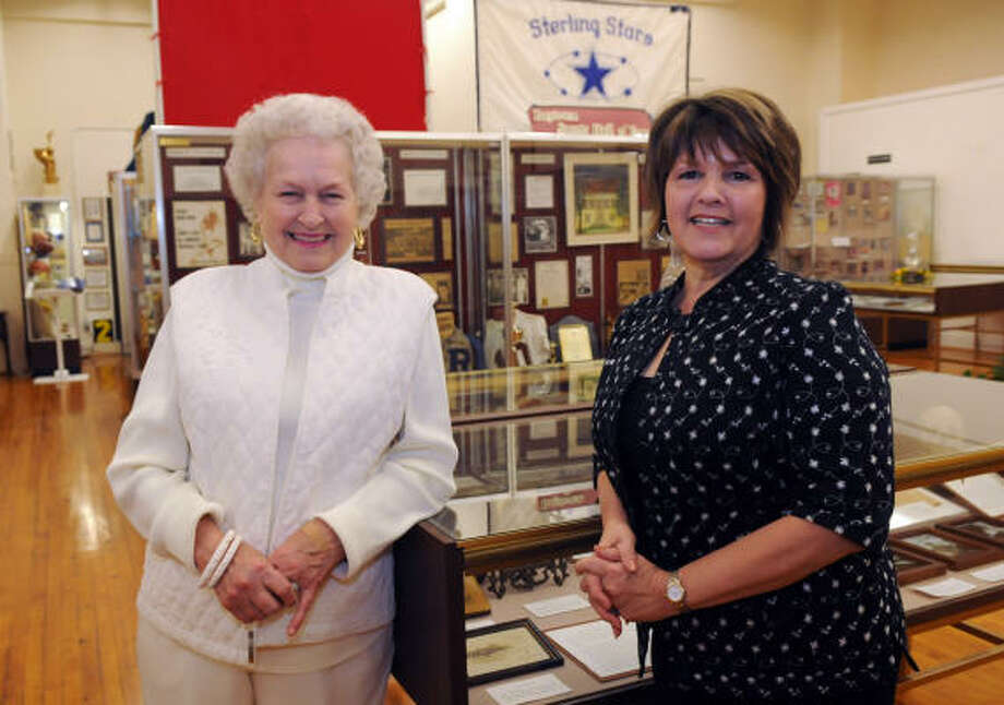 CHANGING OF THE GUARD: Wanda Ellis Mitchell, left, and Terry Presley visit at the Baytown Historical Museum reception honoring outgoing museum director Mitchell and the incoming director Presley. Photo: Kim Christensen, For The Chronicle