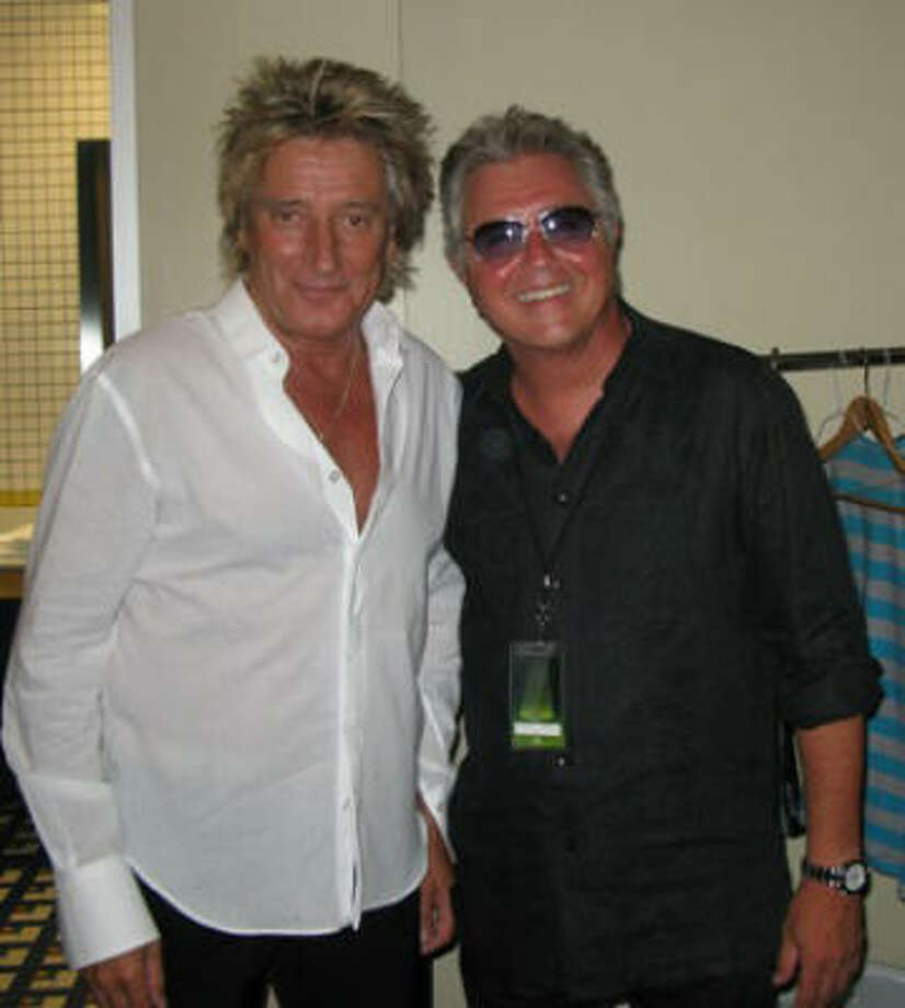 Rod Stewart, left, and Steve Tyrell huddle backstage at the Cynthia Woods Mitchell Pavilion before Stewart's performance. Photo: Shelby Hodge