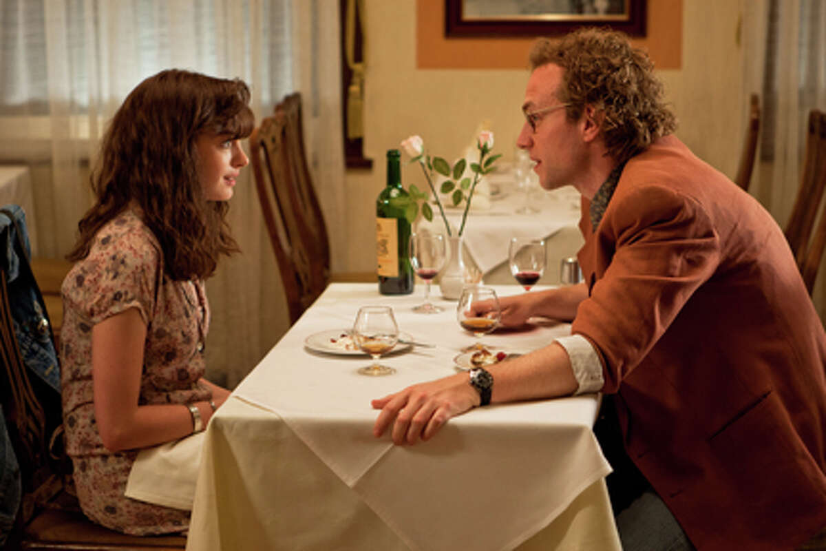 Anne Hathaway as Emma and Rafe Spall as Ian in