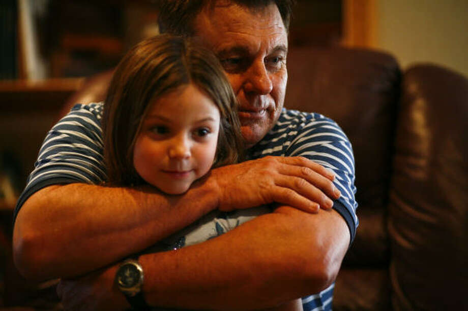 Danny Langford, 60, with granddaughter Malorie, 6, in Texas City, says KBR knew an Iraqi water plant was contaminated. Photo: Michael Paulsen, Chronicle