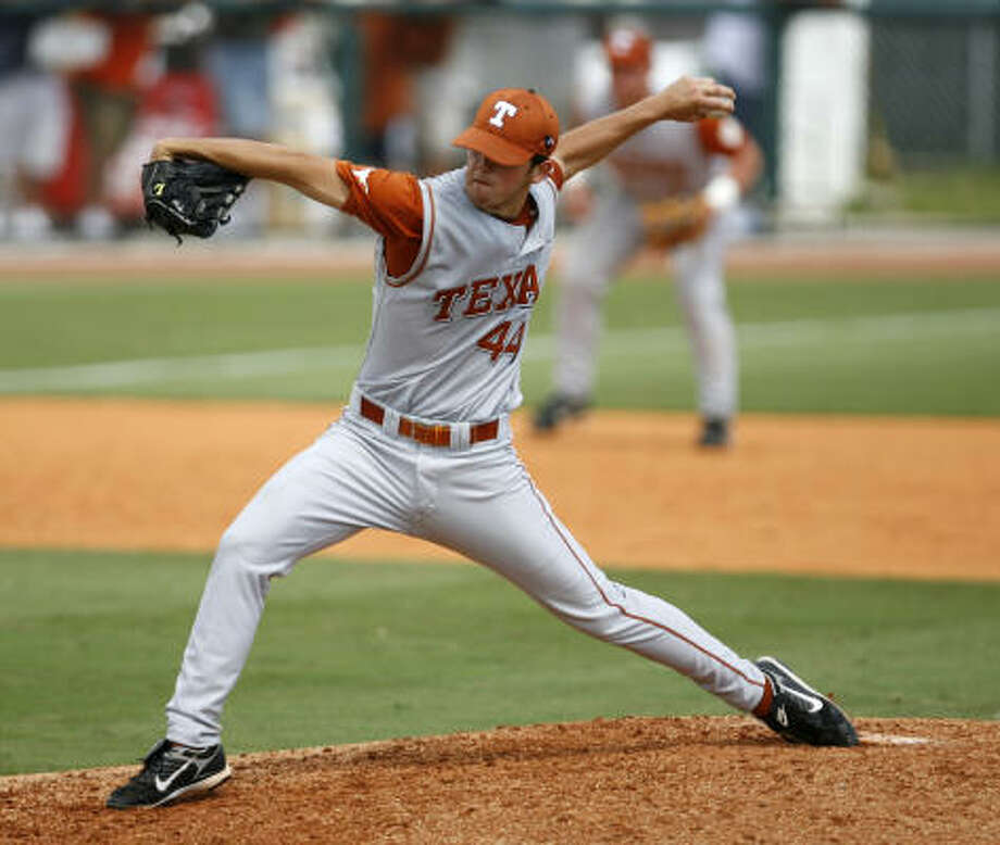 UT relief pitcher Austin Wood picked up the win in the 10 inning game against Texas A&M. Photo: Karen Warren, Houston Chronicle