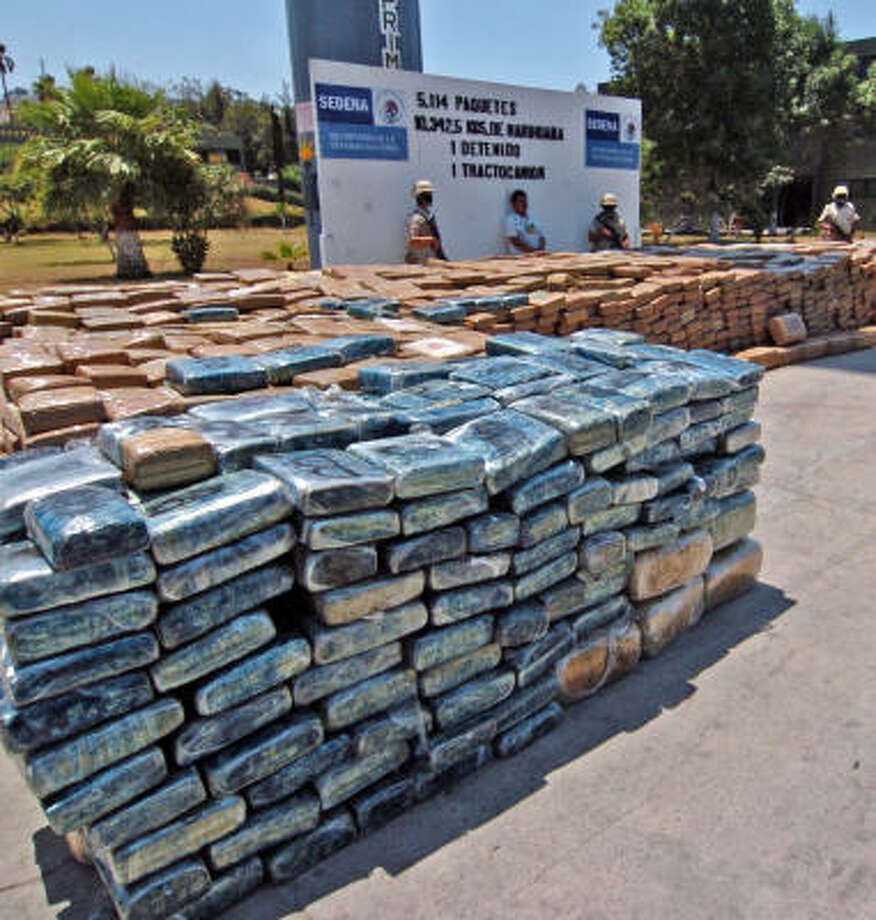 Mexican troups guard 10 tons of marijuana that was seized this week at the border with California. Photo: SAID BETANZOS, AFP/Getty Images