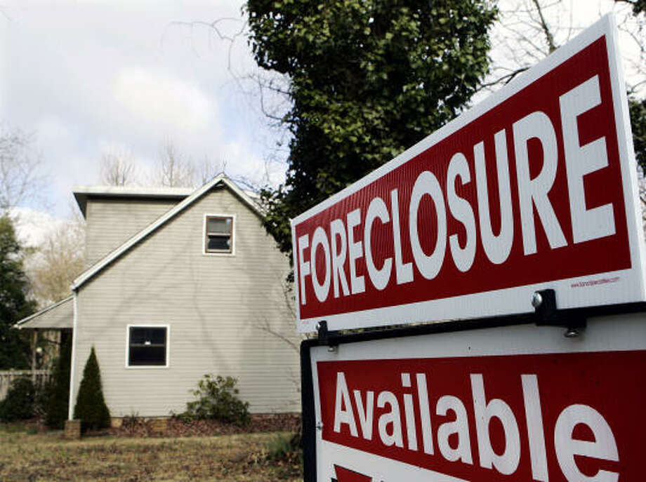 The ongoing mortgage foreclosure crisis has sparked a cottage industry of scam companies offering relief. Photo: Mel Evans, Associated Press