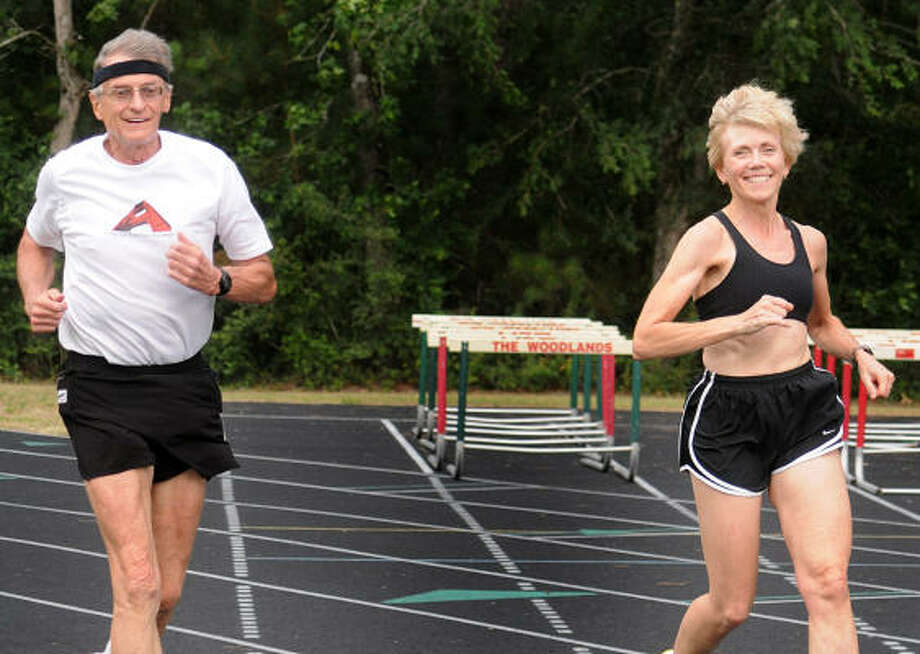 ON THE TRACK: Lou Wilson, of The Woodlands, and his wife, Nora, run laps at The Woodlands High School track. Wilson celebrated his 73rd birthday by running his 100th marathon. Photo: David Hopper, For The Chronicle