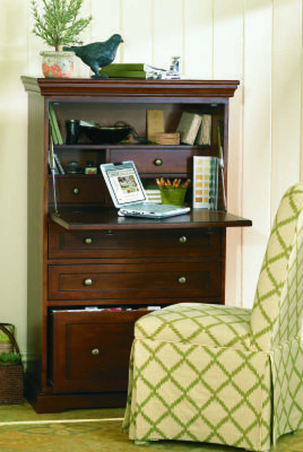 OFFICE ADDITION: The Small Ballard Office Armoire makes a cozy addition to a home office.
