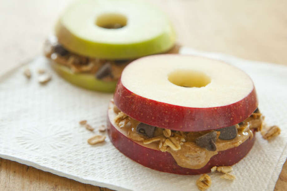 Apple Sandwiches with Granola and Peanut Butter Photo: WHOLE FOODS