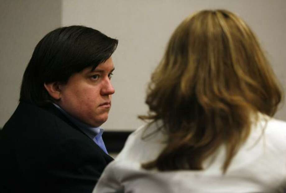 Royce Clyde Zeigler II, left, with defense attorney Dena Fisher, listens on Monday to his brother Hiram Zeigler testify. Photo: Jennifer Reynolds:, Associated Press