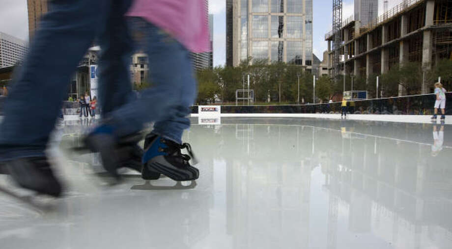 Skaters take to the ice at the outdoor ice rink at Discovery Green. Photo: Steve Ueckert, Chronicle