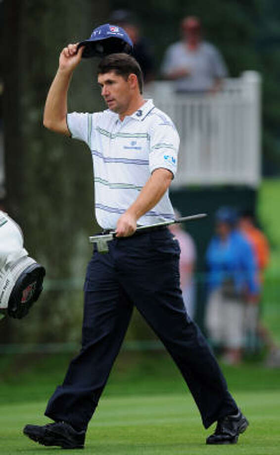 Padraig Harrington doffs his cap on the 18th hole during the third round of the Bridgestone Invitational on Saturday at Firestone Country Club in Akron, Ohio. Photo: Stuart Franklin, Getty Images