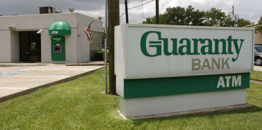 The FDIC contacted 41 potential bidders and received seven bids for Guaranty Bank. Photo: Julio Cortez, Chronicle