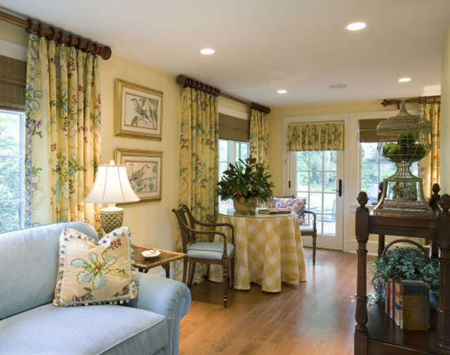 PRETTY PRACTICAL SOLUTION: Made to match the long draperies, a short valance is a practical and pretty solution to the French door. Photo: Melabee M Miller, ? Melabee M Miller