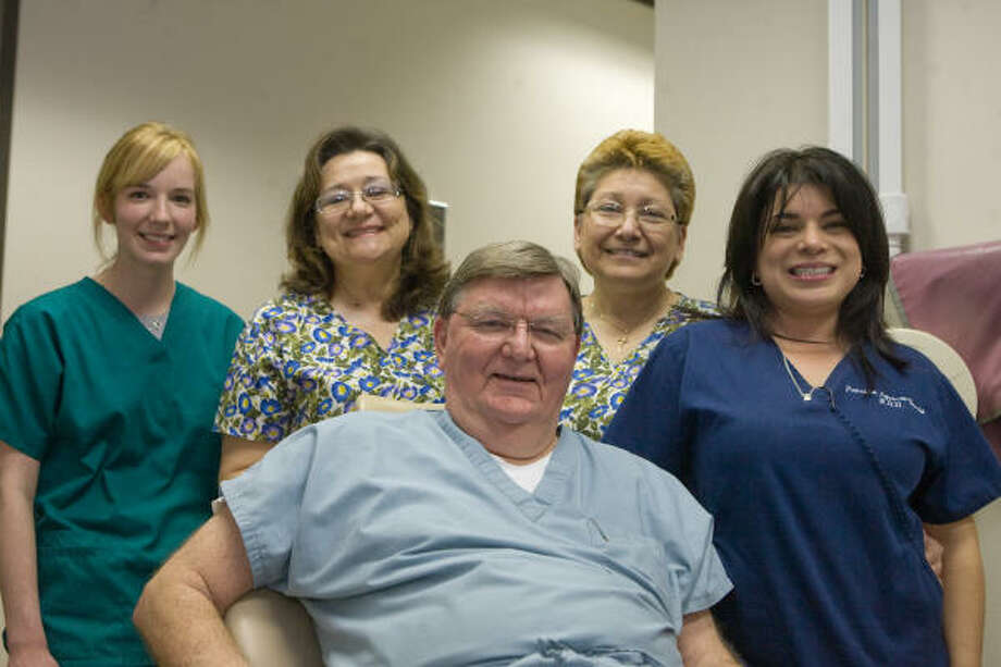 TEAM WORK: Dr. Brad Wilson, D.D.S., took members of his staff on a dental mission trip to Laredo in November. Accompanying him were Ariel Wilson, R.D.A.; Carino Mendoza, R.D.H.; Dobie Moreno, C.D.A.; and Patricia Aguirre-Doria, R.D.H. Photo: R. Clayton McKee, For The Chronicle