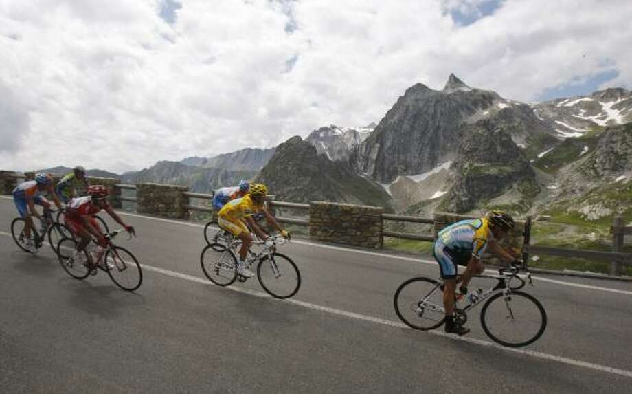 Though ahead in this stretch through the French Alps, Lance Armstrong, right, remains second behind Astana teammate Alberto Contador, left, who held onto the yellow jersey after Tuesday's mountainous stage. Photo: CHRISTOPHE ENA, AP