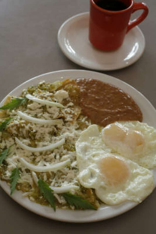 La Guadalupana Bakery & Cafe's version of green chilaquiles includes fried eggs. Purists recoil at the idea of scrambling the eggs into the dish. Photo: CHRONICLE FILE