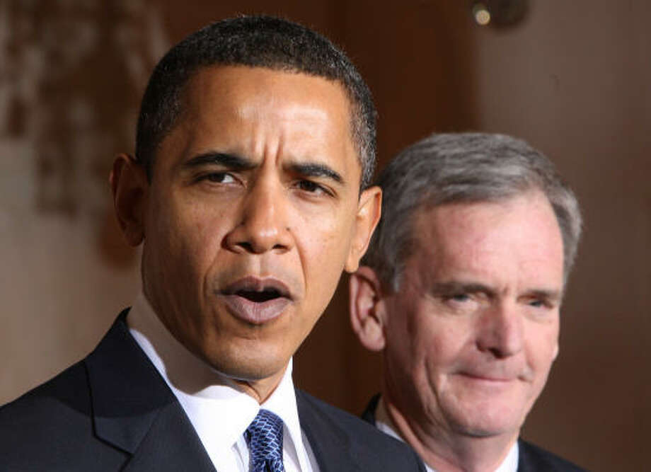 President Barack Obama announces his plans to nominate Sen. Judd Gregg, R-N.H., right, for commerce secretary, Tuesday in the Grand Foyer at the White House. Photo: Ron Edmonds, AP