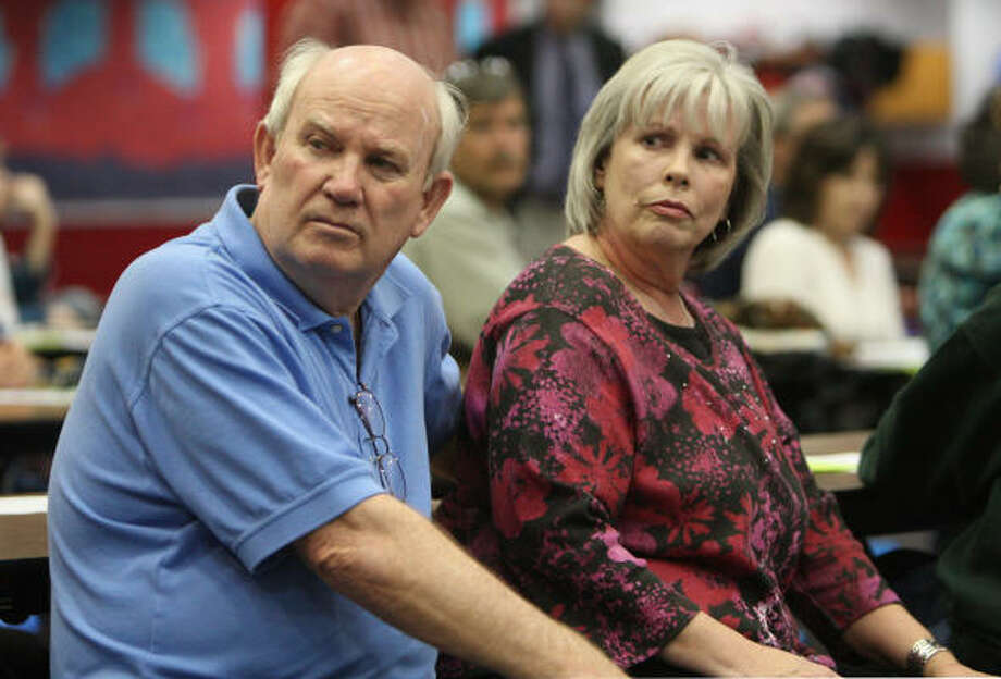 Waller and Jane Euglken, who live in Southdown Village subdivision, attend a Houston-Galveston Area Council public meeting about the proposed grade separation on Texas 6 at FM 529. The meeting was held at Labay Middle School in Copperfield. Photo: Thomas Nguyen, For The Chronicle