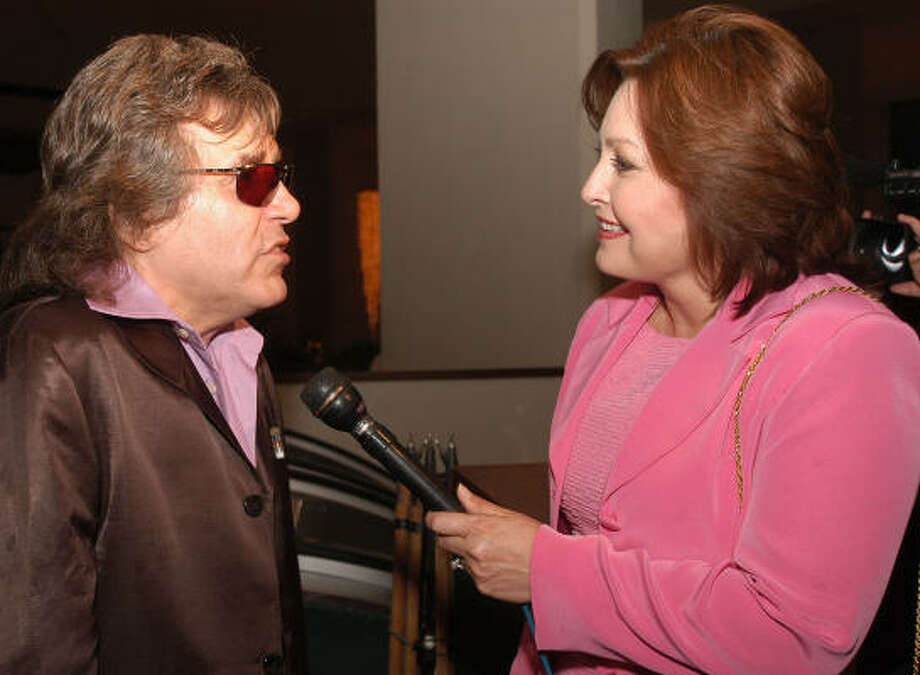 Minerva Perez interviews Jose Feliciano in 2005. Perez and her partners have taped six episodes of Latina Voices: Smart Talk for a local public access station. Photo: Carlos Javier Sanchez, Chronicle File