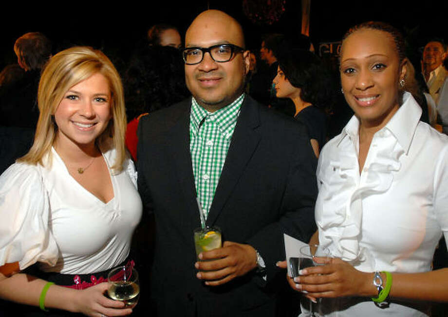 Carrie Johnson, left, Victor Vega and Virginia Sanders were among the fashionable crowd. Photo: Dave Rossman, For The Chronicle