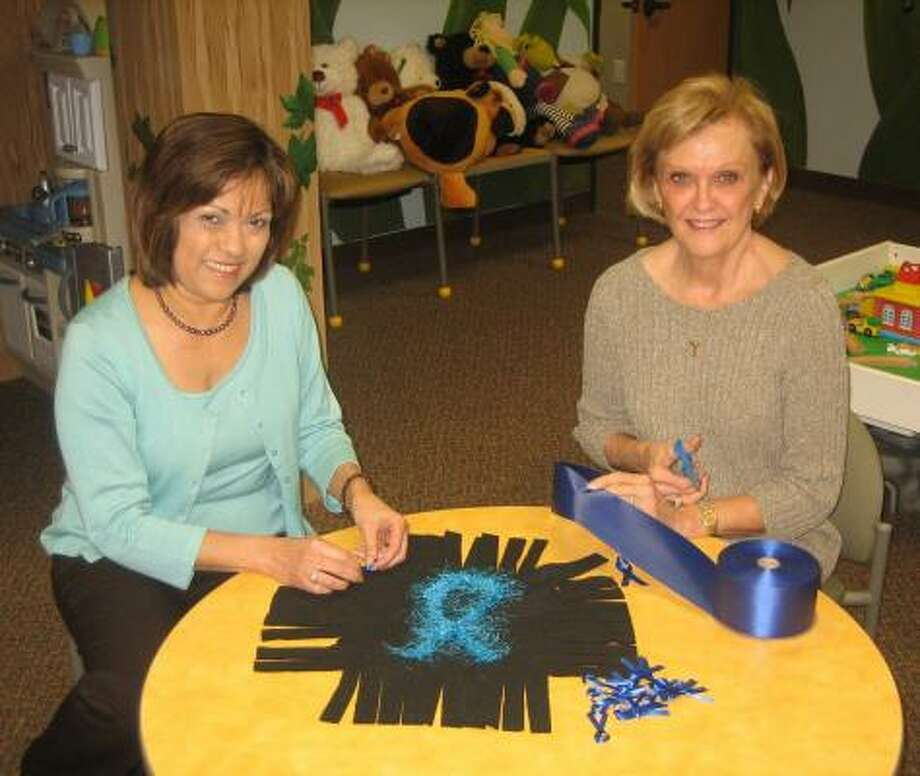 Working on a section for Child Advocates of Fort Bend's Blue Ribbon Quilt are Assistant County Attorney Rose Mary Schultze and CAFB volunteer Janice King. The quilt will be displayed at CAFB's Light of Hope Ceremony marking the beginning of Child Abuse Prevention Month on April 3. Details: 281-341-9955 or www.cafb.org.