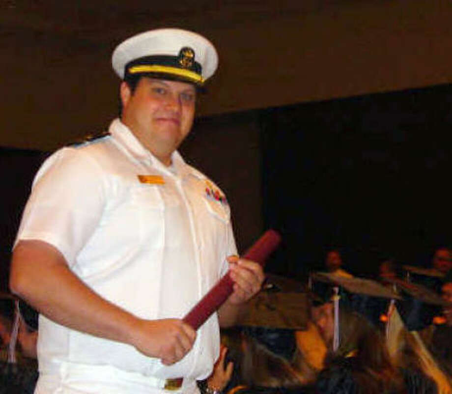 Thomas Urbik is seen at his graduation ceremony at Texas A&M Maritime Academy in Galveston. He's on board the Liberty Sun, which was attacked Monday by Somali pirates. Sugar Land resident Jimmie Joseph also is on the crew, his wife said today. Photo: Katy Urbik, AP