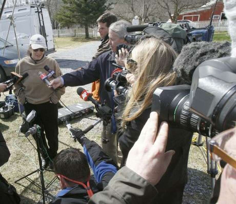 Lea Coggio, the sister-in-law of Captain Richard Phillips, talks to reporters in Underhill, Vt. Phillips has a radio and contacted the Navy and the crew of the Maersk Alabama to say he is unharmed, the Maersk shipping company said. Photo: Toby Talbot, AP
