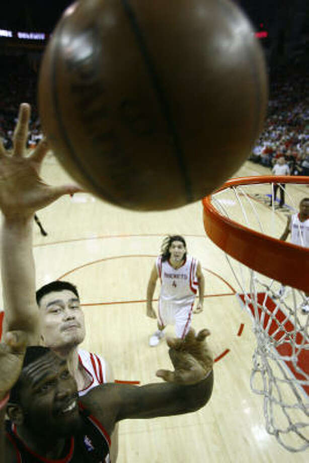 Rockets center Yao Ming, rear, battles the Blazers' Greg Oden for a rebound in the first half of the Rockets' win in Game 6 on Thursday night at Toyota Center. Photo: Nick De La Torre, Chronicle