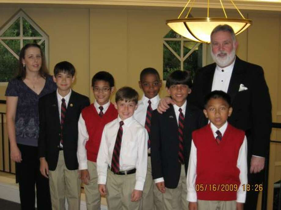 Representing the Fort Bend Boys Choir of Texas are, from left: Tiana Mortimer, executive director; Nicholas Steele, tour choir; Chap Obregon, town choir; Ryan Williams and Alexandre Chaumette, training choir; Emmanuel Arredondo, tour choir; Joshua Tia, town choir; and William R. Adams, founder and artistic director. Photo: Courtesy, Fort Bend Boys Choir