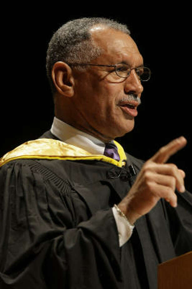 "Charles F. Bolden Jr. speaks to graduates earlier this year at Baylor College of Medicine. On Wednesday, he said the space station is ""bridge to human exploration beyond low Earth orbit."" Photo: Melissa Phillip, Chronicle"