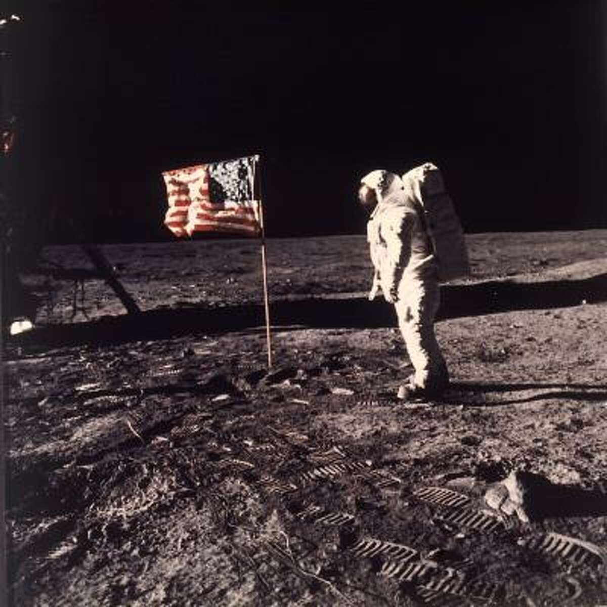 Buzz Aldrin stands on the lunar surface after a harrowing 70-minute descent.