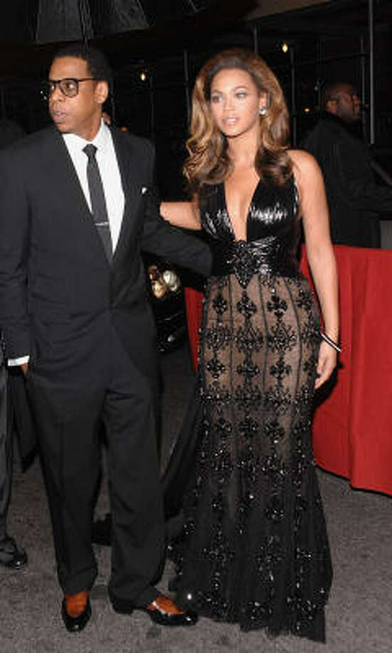 Hip-hop singer and entrepreneur Jay-Z and his wife singer- actress Beyonce Knowles attend the premiere of 'Cadillac Records' on Monday, Dec. 1, 2008 in New York. Photo: Evan Agostini, AP