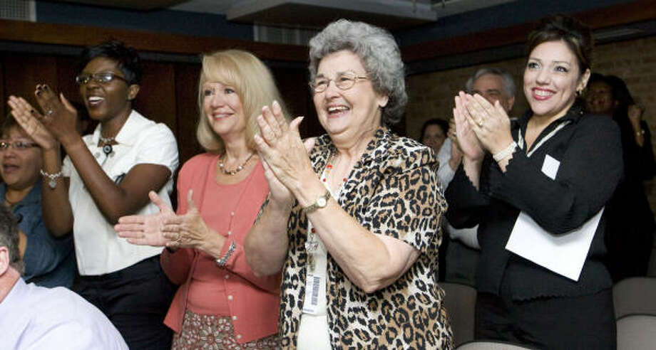 Aldine ISD's Perla Davila, far left, Tameka Alford-Stephens, Janet Ray, Bettie Stubblefield and Patricia Guidrey react as Aldine ISD was awarded the 2009 Broad Prize for Urban Education today.  The Broad Prize is the largest education award in the country that also includes $1 million in scholarship money for Aldine students. Photo: Brett Coomer, Chronicle