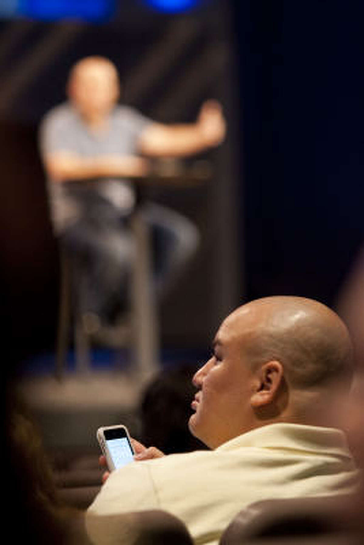 """Pimentel's iPhone becomes a part of the Sunday evening service earlier this month at Woodlands Church. """"Using all these resources that we have, like Facebook and Twitter, to get closer to the pastor is great; it's awesome,"""" Pimentel says."""