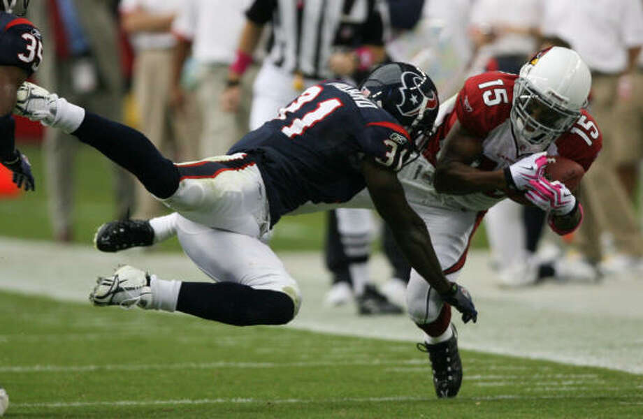 Texans safety Bernard Pollard makes a tackle against Arizona. He has made three starts since joining the team. Photo: Billy Smith II, Chronicle