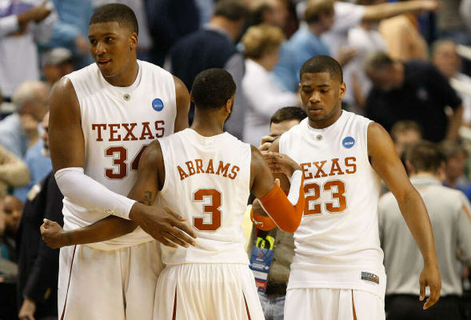 Dexter Pittman (34) and A.J. Abrams (3) have become best friends and have pushed the Longhorns into the NCAA Tournament. Photo: Streeter Lecka, Getty Images