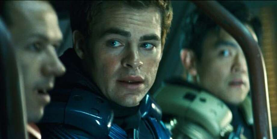 Chris Pine, center, and John Cho, right, star as Capt. James T. Kirk and Sulu in director J.J. Abram's version of Star Trek, which comes to theaters May 8. Photo: Industrial Light & Magic  , Assciated Press
