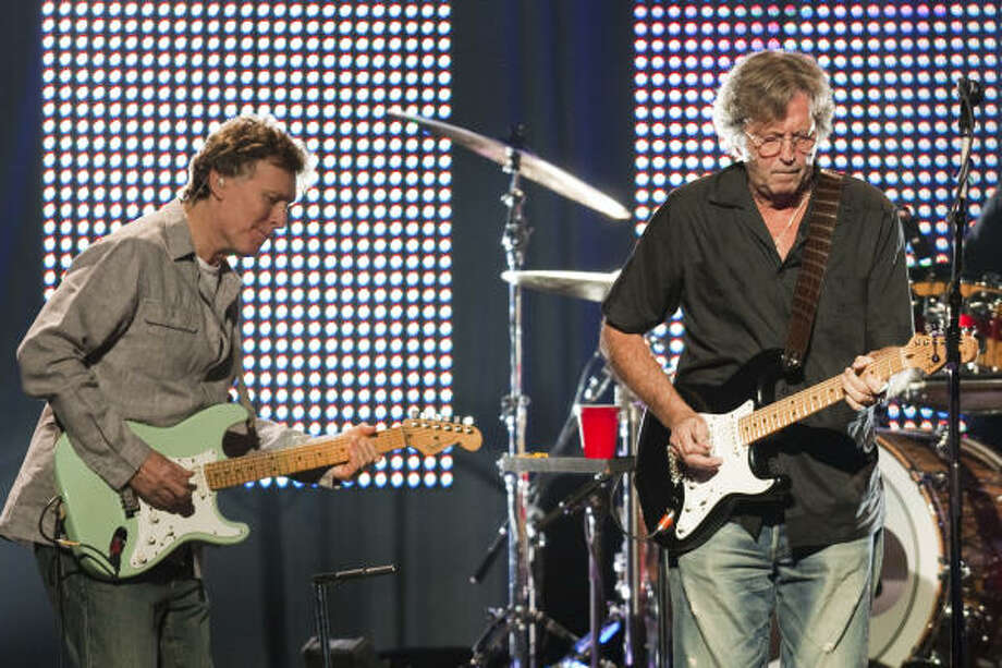 Steve Winwood, left, and Eric Clapton, mixed greatest hits with blues for Wednesday night's lineup at the Toyota Center, the 10th stop in a 14-city tour. Photo: Smiley N. Pool, Chronicle