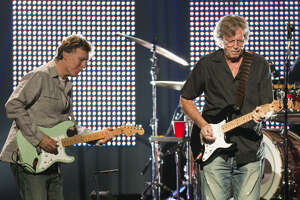 Steve Winwood, left, and Eric Clapton, mixed greatest hits with blues for Wednesday night's lineup at the Toyota Center, the 10th stop in a 14-city tour.