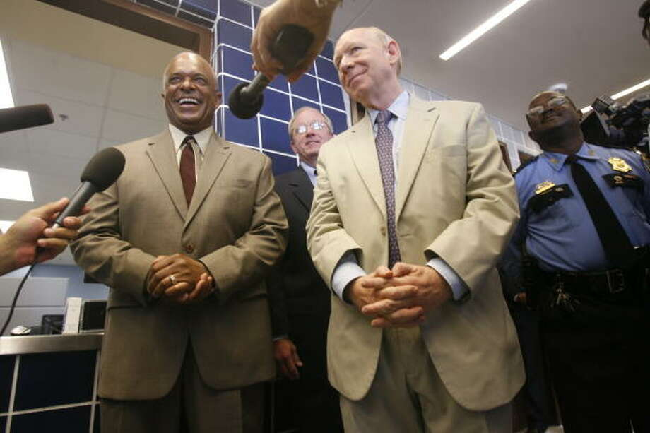 HPD Chief Harold Hurtt (left) and Houston Mayor Bill White helped open the new 55,000-square-foot Houston Police Department property room Thursday.  Photo: Mayra Beltran, Chronicle