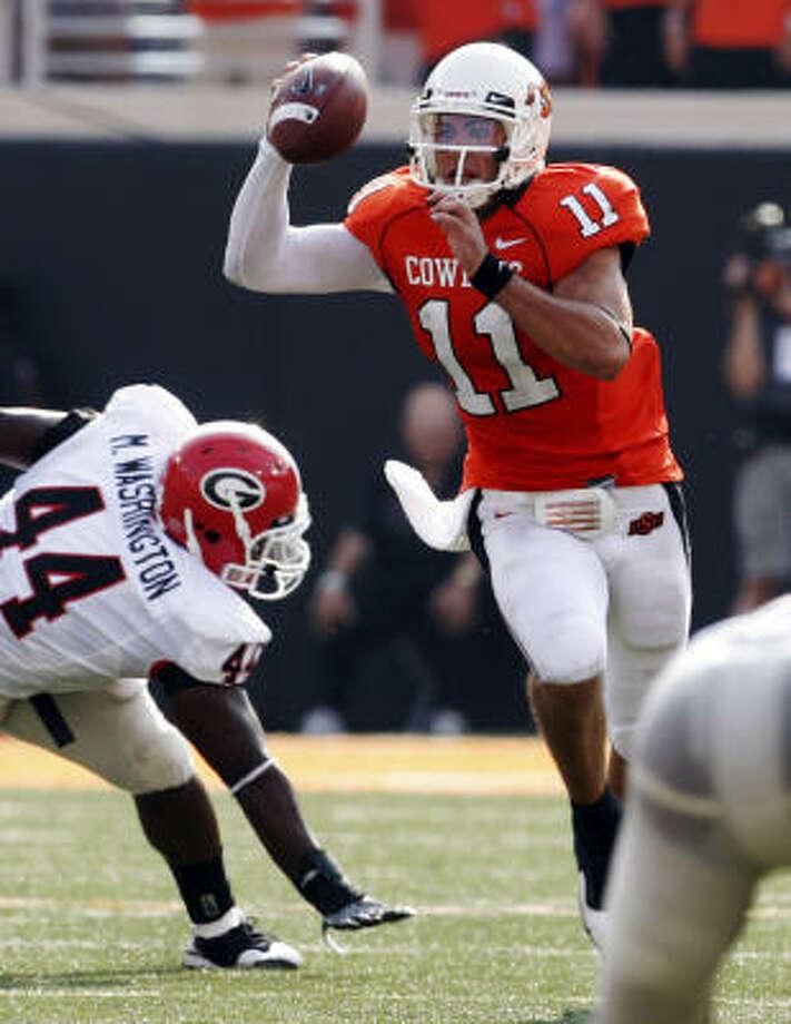Quarterback Zac Robinson led the Oklahoma State Cowboys to a win over Georgia last week. Photo: Sue Ogrocki, AP