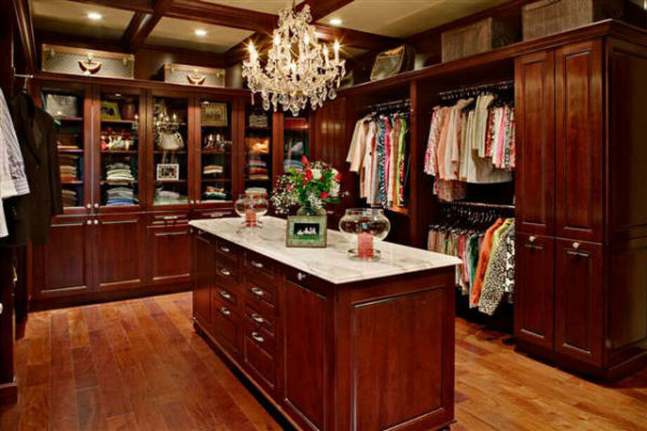 DUAL DESIGN: A closet features stylish double storage in cabinets and cupboards, which are liberated from the kitchen.
