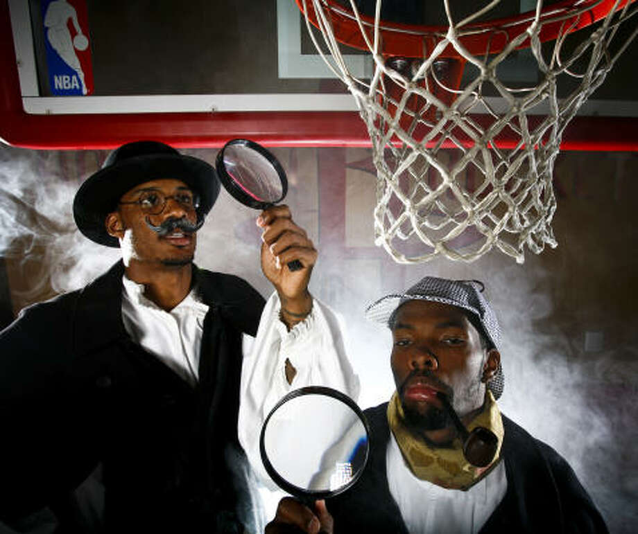 Newcomer Trevor Ariza (left, as Dr. Watson) and point guard Aaron Brooks (as Sherlock Holmes) will solve the mystery of what kind of team the Rockets are. Photo: Michael Paulsen, Chronicle