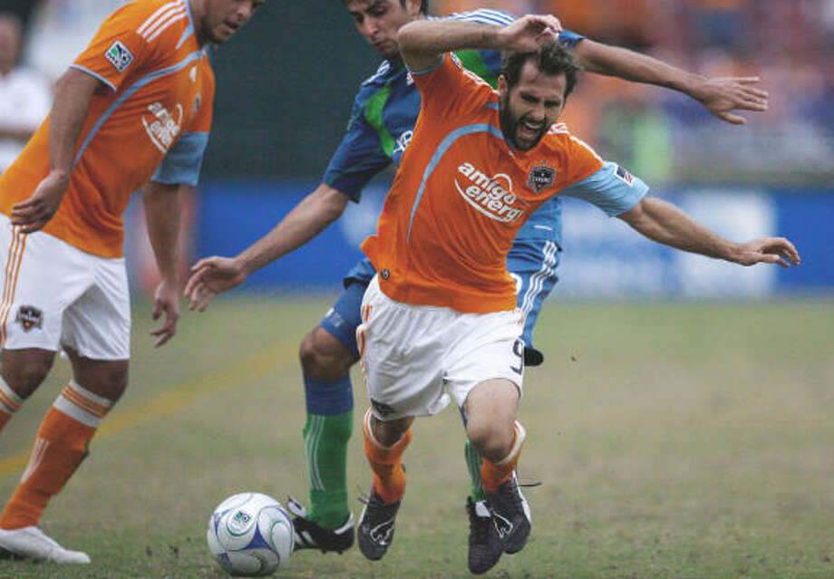 Brian Mullan started 23 games for the Dynamo. Photo: Julio Cortez, Chronicle